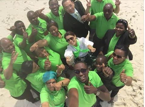 green world members at beach